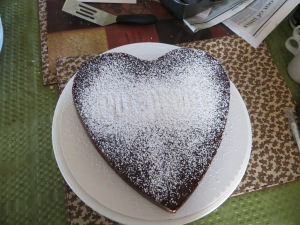 Letters covered with powdered sugar.